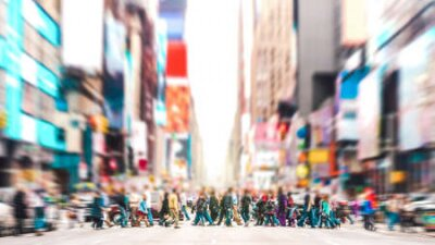 Obraz Defocused background of people walking on zebra crossing on 7th avenue in Manhattan - Crowded streets of New York City during rush hour in urban area - Vivid sunset filter with soft sharp focus