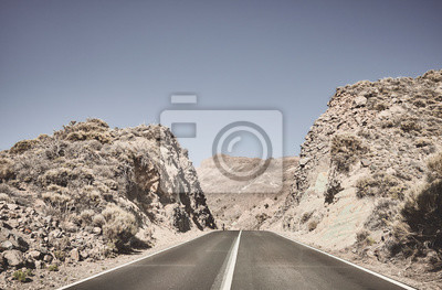 Deserted road into the unknown, color toned picture, Tenerife, Spain.
