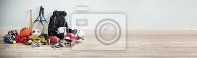 Obraz Different Type Of Sports Equipment On Wooden Desk