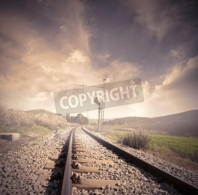 Obraz Długie kolejowe na wschód słońca
