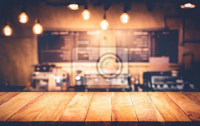 Obraz Drewniana blat z blur counter kawiarni, cafe background.For montage produktu lub kluczowych wizualne uk? Ad graficzny