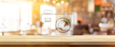 Obraz Drewniany stół na blur kawiarni (kawiarnia) wnętrze tła, panoramiczny baner