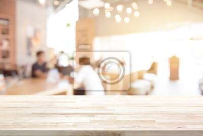 Obraz Drewniany stół na blur restauracji (cafe) wnętrze tła