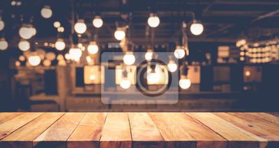 Obraz Drewno blatu stołu na rozmazane powierzchni countercafé z tłem żarówki background.For produktu produktu montażowego lub projektu klucza wizualnego