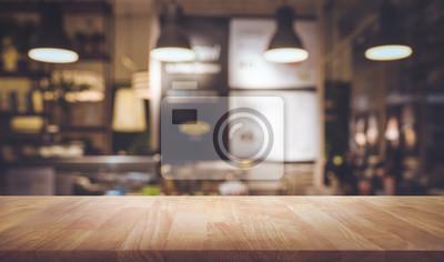 Obraz Drewno blatu stołu na rozmyte licznik kawiarni z? Arówki background.For montage produktu wy? Wietlania lub projektowania kluczowych wizualne