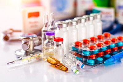 Obraz Drug prescription for treatment medication. Pharmaceutical medicament, cure in container for health. Pharmacy theme, capsule pills with medicine antibiotic in packages.