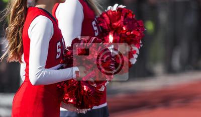 Obraz Dwie cheerleaderki z czerwonymi i białymi pom poms