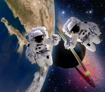 Obraz Dwóch astronautów handshake Spaceman opalania saturn planety ziemia Sci Fi przestrzeni kosmicznej galaktyki. Elementy tego zdjęcia dostarczone przez NASA.