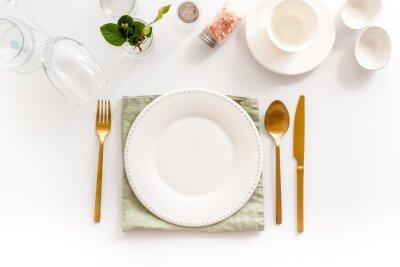 Obraz Eating utensil set - table setting for dinner with plate on napkin
