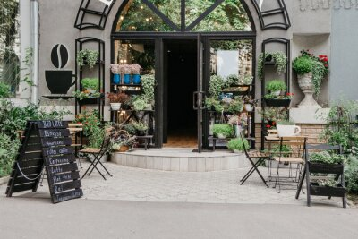 Obraz Eco cafe on street and flower studio, small business in city, reopening after covid-19, outdoor interior