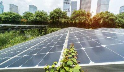 Obraz Ecological energy renewable solar panel plant with urban landscape landmarks