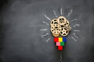 Obraz Education concept image. Creative idea and innovation. Wooden gears light bulb metaphor over blackboard