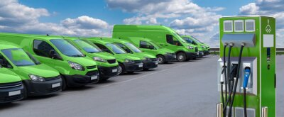 Obraz Electric vehicles charging station on a background of a row of vans. Green transportation concept