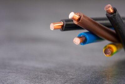 Obraz Electrical copper cable wire close-up isolated on shiny metal background