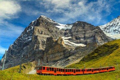 Obraz Elektryczny pociąg turystyczny i Eiger North Face, Berneński Oberland, Szwajcaria