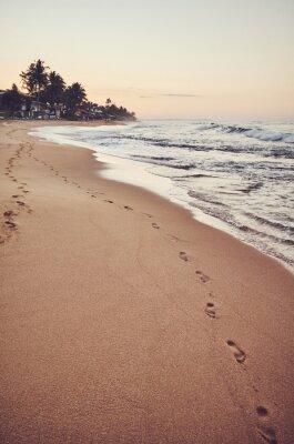 Empty tropical beach at sunrise, color toning applied, Sri Lanka.