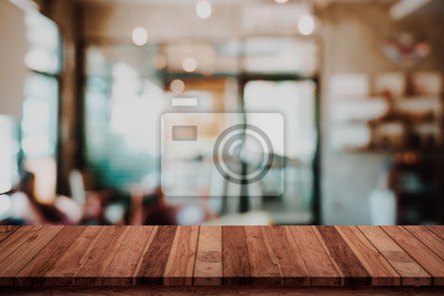 Obraz Empty wood table with blur cafe or coffee shop background.