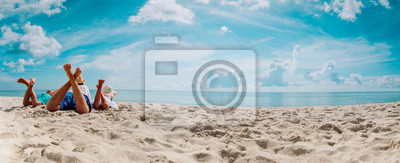 Obraz father with son and daughter relax on beach vacation, panorama