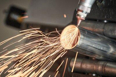 Obraz Fiber laser tube cutting machine. metal pipe cutting with sparks
