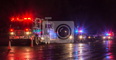Obraz First Responders - firefighters and police officers - on a wet night