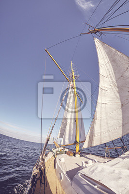 Fisheye lens picture of an old sailing ship, color toning applied.