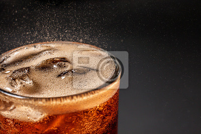 Obraz Fizz sparkling Cola water Refreshing bubbly Soda Pop with Ice Cubes. Cold soft drink cola carbonated liquid fresh and cool iced drink in a glasses . Refreshing and quench thirst concept .