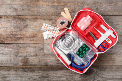 Obraz Flat lay composition with first aid kit and space for text on wooden background