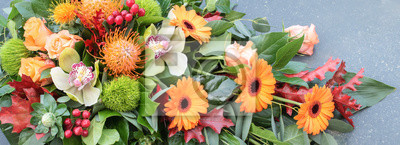 Obraz Flower arrangement. Overhead view and close up of orange flowers. Floral  banner.