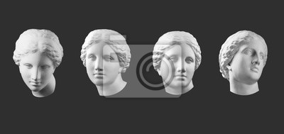 Obraz Four gypsum copy of ancient statue Venus head isolated on black background. Plaster sculpture woman face.