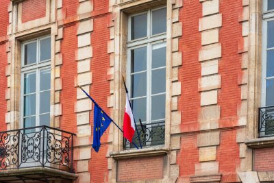 French flag and EU Community Flag in Paris city, France.