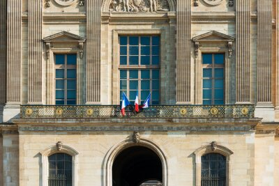 French flag in Paris city, France.