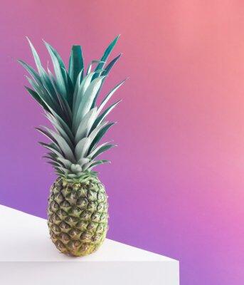 Obraz Fresh and ripe pineapple against purple pastel background. Concept art. Minimal surrealism background. Summer fruit gravity concept.