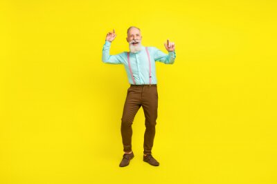 Obraz Full length body size photo elder man wearing fashionable clothes relaxing on weekend isolated bright yellow color background
