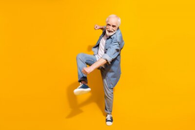 Obraz Full size portrait of excited cheerful person dancing make moves beaming smile isolated on yellow color background