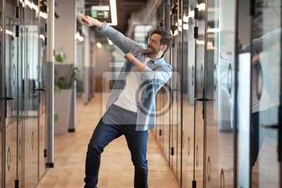 Obraz Funny happy male employee dance in office celebrating