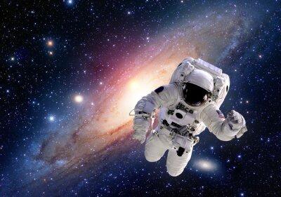 Obraz Garnitur astronauta kosmonauta kosmos ludzie układ słoneczny wszechświat. Elementy tego zdjęcia dostarczone przez NASA.