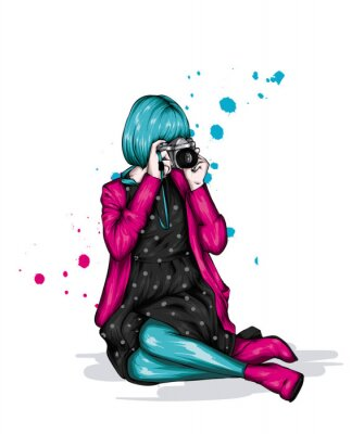 Obraz Girl in stylish clothes and with a camera. Fashion and style, vintage and retro.