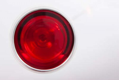Obraz Glass of red wine with shadow.Top view . Close-up