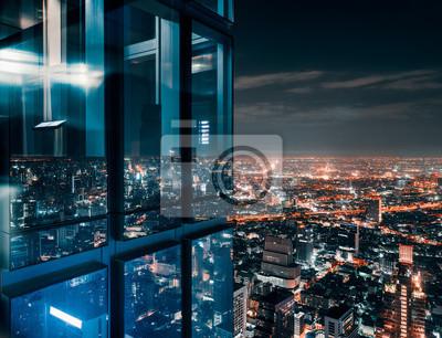 Obraz Glass window with glowing crowded city