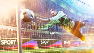 Obraz Goalkeeper catches the ball in the soccer stadium