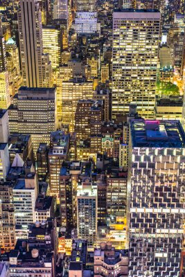 Obraz Golden cityscape of New York City buildings and lights at night