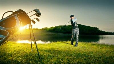 Obraz Golf. Golfer makes a strong kick of the ball.