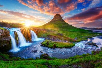 Obraz Gorgeous landscape with rising sun on Kirkjufellsfoss waterfall and Kirkjufell mountain, Iceland, Europe.