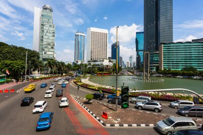 Green light on traffic in the heart of Jakarta business and downtown district in Indonesia capital city on a sunny day