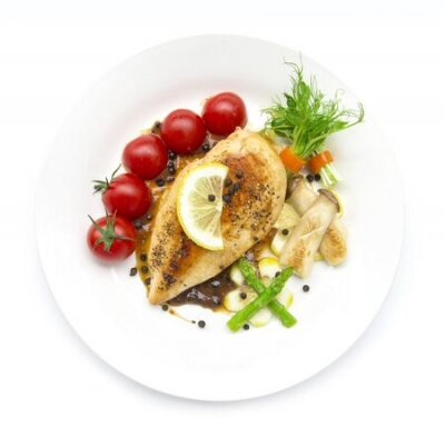Obraz Grill Chicken breast  or chicken steak with black peppers sauce topped black peppers decorate asparagus,oyster mushroom,tomato and lemon carved style  top view isolated on white background