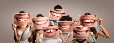 Obraz group of happy people holding a picture of a mouth smiling on a gray background