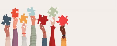Obraz Group of multi-ethnic business people with raised arms holding a piece of jigsaw. Colleagues of diverse races and culture. Cooperate and collaborate. Concept of teamwork and success