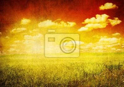 grunge obrazu pole zielone i niebieskie niebo