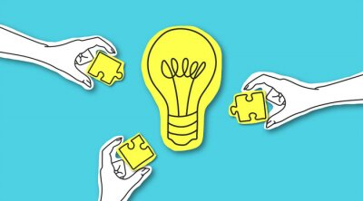 Obraz Hands with puzzle peaces around glowing light bulb