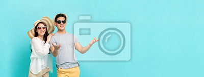 Obraz Happy couple in summer beach casual clothes on light blue banner background